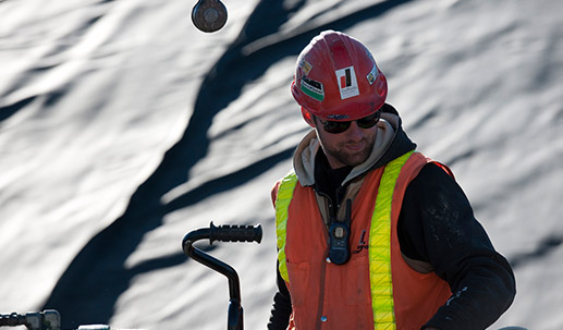 Dufferin Construction Employee in Red Hard Hat