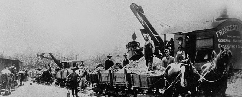 Dufferin awarded first provincial highway project. Grading of the Rouge Hill portion of Kingston Road (Highway 2) in Toronto, Ontario. - 1917